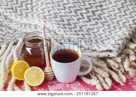 a cup of hot tea with lemon blanket - food and drink