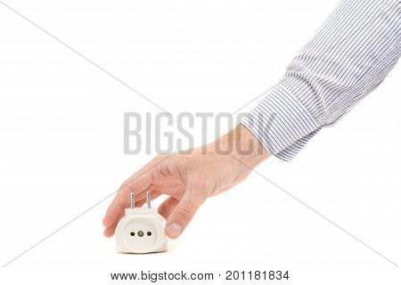 Male hand holding a tee in a white socket on a white background isolating