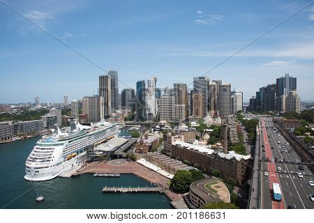 SYDNEY,NSW,AUSTRALIA-NOVEMBER 20,2016: Elevated view over cruise ship at the Overseas Passenger Terminal, the Circular Quay, city skyline and roadway in Sydney, Australia.