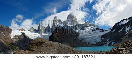 Wide panorama of Mount Fitz Roy and Laguna de los Tres There were some clouds up in the sky but not enough to hide this beauty. Probably one of the most photogenic mountains and a really nice and long (4 hours) hike to get there. Picture taken in El Chalt