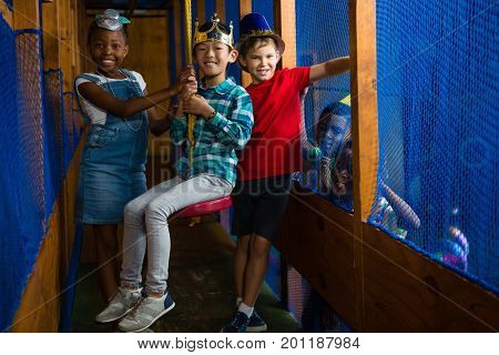 Portrait of children in jungle gym at birthday party
