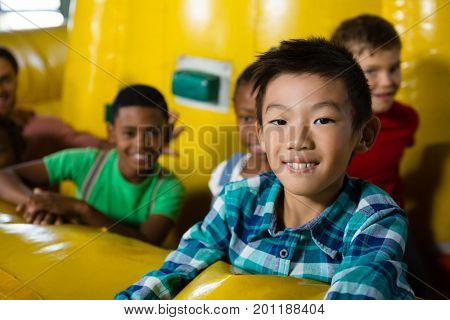 Children on bouncy castle during party