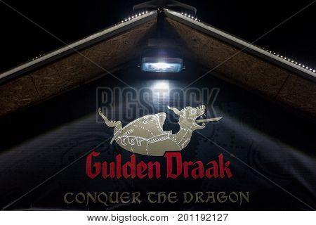 BELGRADE SERBIA - AUGUST 19 2017: Logo of Gulden Draak beer taken on an Gulden Draak shop in Belgrade at night. Gulden Draak is one of the most known Belgian beers sold worldwide