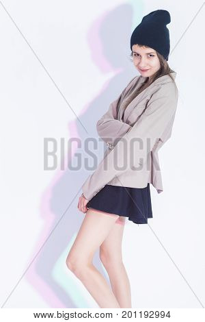Youth Fashion and Lifestyle Concepts. Portrait of Happy and Glad Exclaiming Thin Brunette Girl in Trendy Jacket Posing in Sexy Skirt On White. Vertical Image