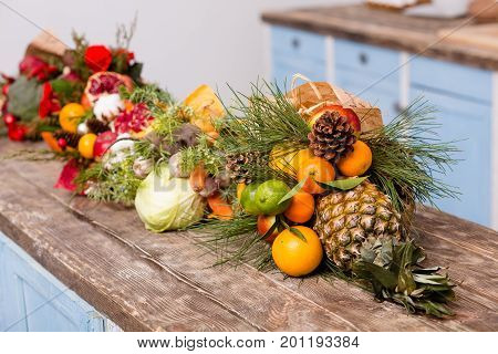 Original compositions of fuits in bouquets. Fruits and vegetables prettily wrapped in bouquets.