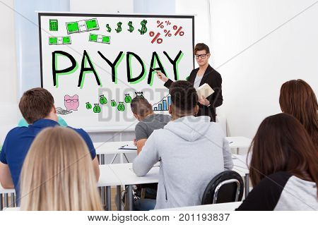 Teacher Giving Payday Lecture To Group Of Students