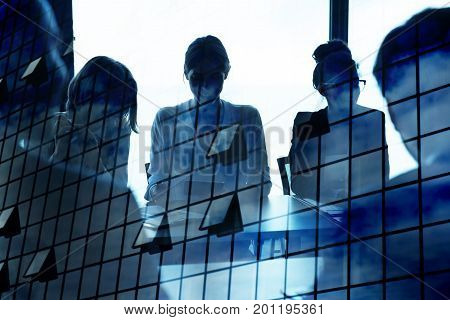 Silhouette of businessperson in a modern office with skyscraper effect. concept of partnership and teamwork