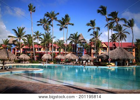 Hotel Punta Cana Princes, Dominican Republic - July 08, 2016: Swimming pool in tropical hotel Punta Cana Princess set on Arena Blanca Beach, this is relaxed, adults-only all-inclusive resort.