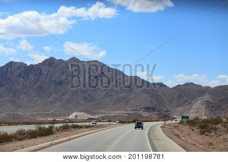 NEVADA, USA--Roads from Las Vegas City heading toward Boulder City and Bullhead City, with the mountains on a sunny day as the background in August 2015.