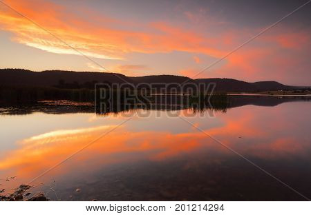 Sunset Colour Reflections In The Lake Penrith Australia