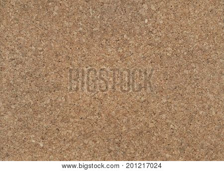 Large piece of corkboard suitable for use as background texture.The texture of the cork