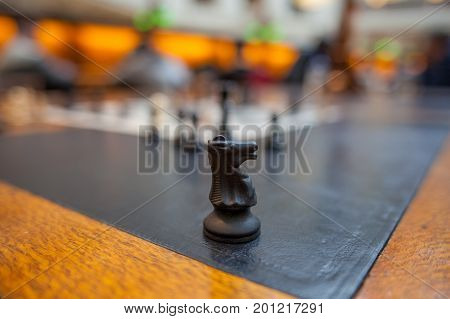 Vintage horse chess piece on blurred background closeup with copy space