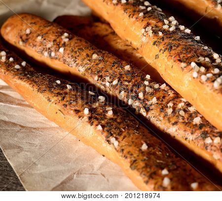 Fragrant bread sticks with original spices on pape
