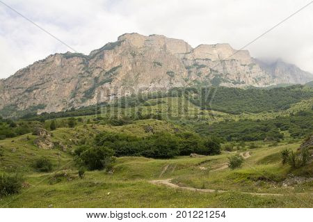 Mountain country road in the foothills hiding in the clouds Caucasus Russia