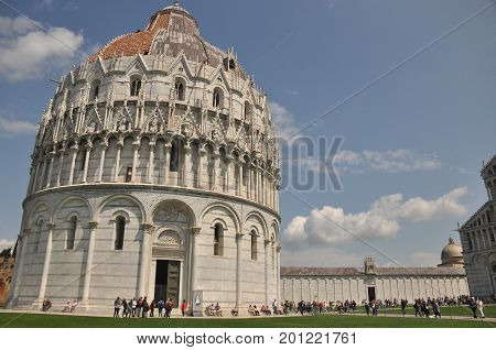 Baptistery of San Giovanni in Pisa. Historic building along the tower curve.