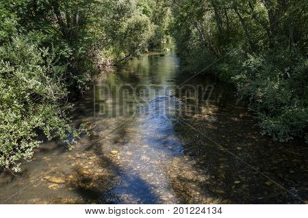 Views of the River Bernesga on its way through La Pola de Gordon Municipality, in Leon Province, Spain