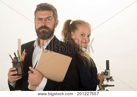 Girl And Man In Suit And Uniform. Classroom And Education