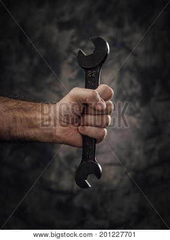 Worker Holding A Spanner