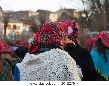 Group of Women with Red Scottish Kerchief and Shawles in Public Ground