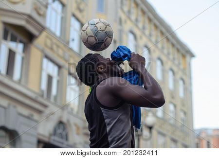 MOSCOW RUSSIA - August 15 2017 man juggles with a football on his head