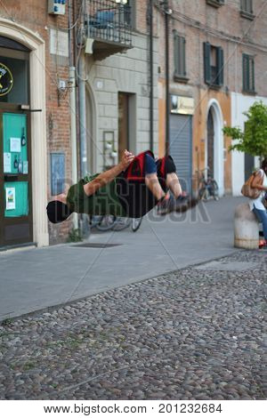 Ferrara, Italia - August 23, 2017: The Ferrara Buskers Festival is dedicated to the art of the street. The artist performs a deadly leap backwards in the street