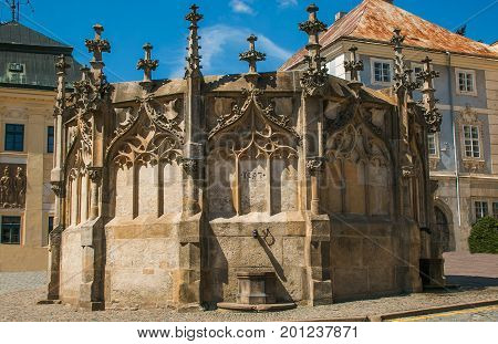 Photo of old gothic stone fountain in the historic center of Kutna Hora, Czech Republic