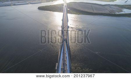 The Arthur Ravenel Jr. Bridge over the Cooper River in South Carolina, USA at dusk.