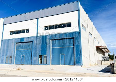 Exterior industrial warehouse in Spain in the day