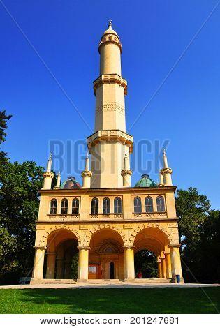 Minaret in Lednice castle park in sunny day vertical photo