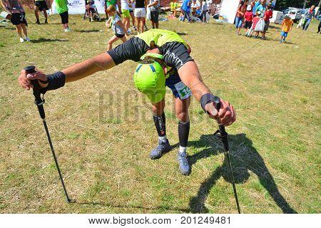 Retezat Romania - August 6 2016: Tired athlete after finishing a trail running marathon. Shot taken on August 6th 2016