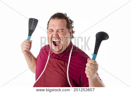Cheerful funny cook. Kitchen tools. Fat guy. Laughter and joy.