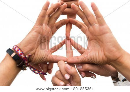 youth culture, gesture and people concept - close up of hippie friends showing peace hand sign outdoors