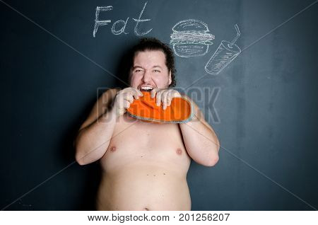 A man dreams of eating. Hunger and diet.