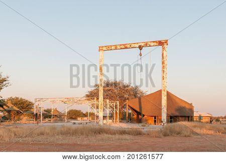 ETOSHA NATIONAL PARK NAMIBIA - JUNE 26 2017: Structures of an old elephant abattoir at the Olifantsrus Rest Camp in the Etosha National Park at sunrise