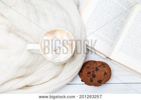 Hot chocolate cookies knitted sweater book. Flat lay