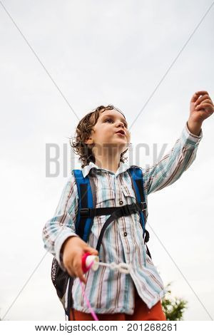 A Boy Is Playing With Soap Bubbles.