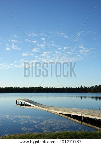 Quiet lake and pier next to the bog