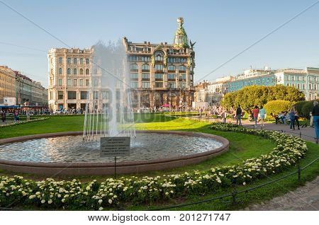 ST PETERSBURG RUSSIA-AUGUST 15 2017. Zinger House on Nevsky Prospect in the historic center of the city and fountain on the foreground. Summer evening in St Petersburg Russia