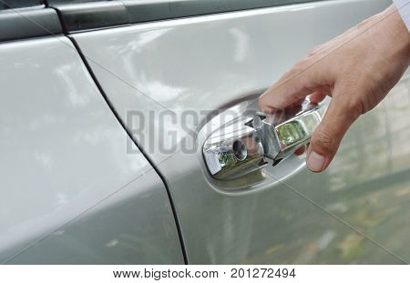 car door handle opened by hand down and pulling