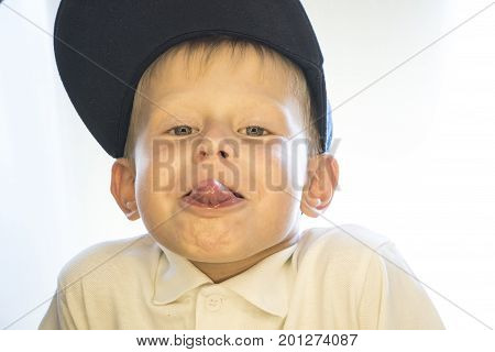 The Boy Shows The Tongue.