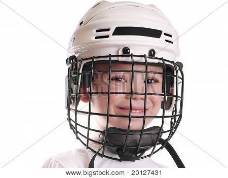Boy in hockey helmet