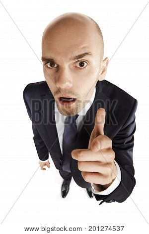 Surprised Businessman Points His Finger At You