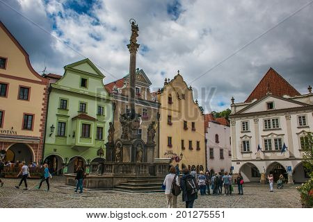 CESKY KRUMLOV, CZECH REPUBLIC - AUGUST 13, 2017: Tourists visiting the main square of Cesky Krumlov medieval city