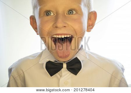 A Little Boy Is Showing His Tongue