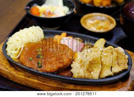 Pork Hamburg, Bacon And Fried Chicken Ontop With Teriyaki Sauce