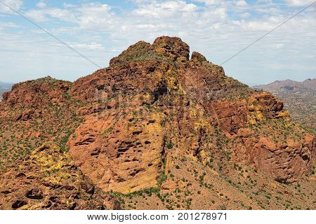 Rising from the desert floor in east Mesa Mount McDowell known as Red Mountain