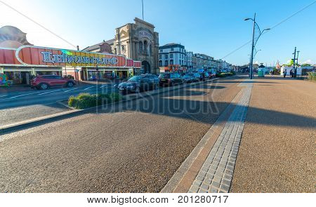 Great Yarmouth, England - August 17, 2017: Marine Parade is situated on the Great Yarmouth coastline in East Anglia. Bustling pier with seaside theatre shows, arcades and rides.