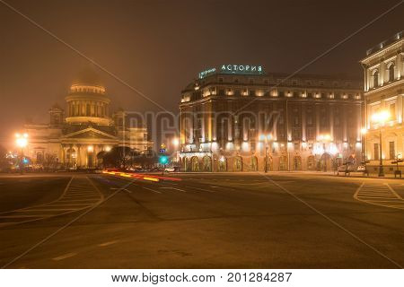 ST PETERSBURG, RUSSIA - MARCH 12, 2017: A foggy mystical night on St. Isaac's Square. St. Isaac's Cathedral and the Astoria Hotel. Night St. Petersburg