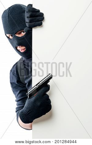 The Criminal With The Gun Points To The Space On The Poster