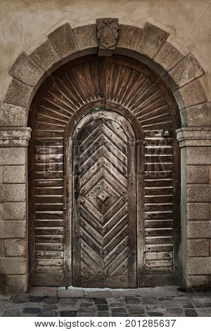 Old wooden door from plank, vintage style, retro elements
